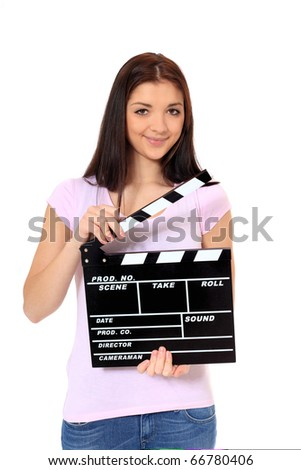 Attractive teenage girl holding clapperboard. All on white background. - stock photo