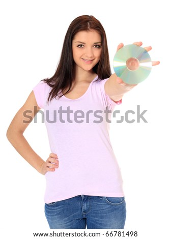 Attractive teenage girl holding dvd. All on white background. - stock photo