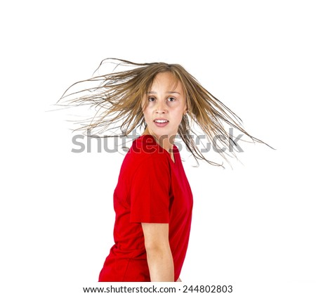 attractive teenage girl with brown hair in motion - stock photo