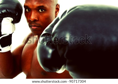 Attractive thirty something black boxer man over white with gloves. - stock photo