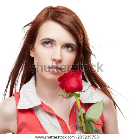 attractive thoughtful casual caucasian brunette young  woman holding red rose. isolated on white - stock photo