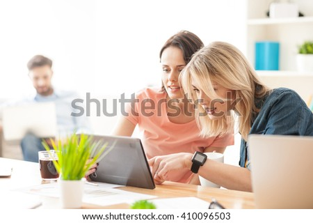 Attractive two female colleagues are making a break - stock photo