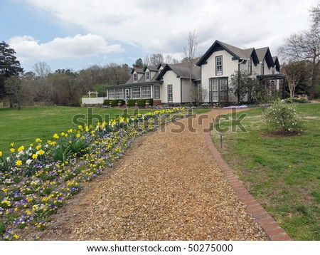 Attractive vintage country house and gardens in Northern Georgia - stock photo