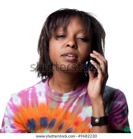 Attractive woman answering the phone - stock photo