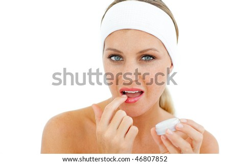Attractive woman applying lip balm isolated on a white background - stock photo