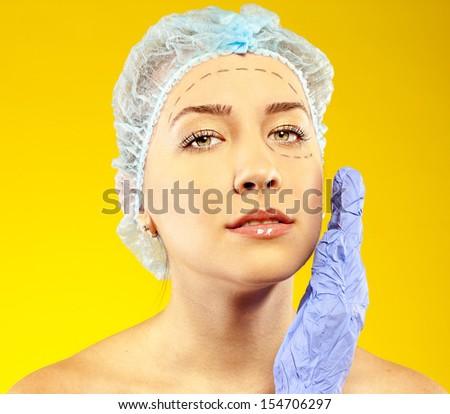 attractive woman before surgery. studio - stock photo