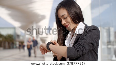 Attractive woman checking the time - stock photo