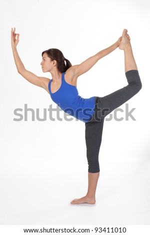 Attractive Woman doing Standing Bow Yoga Pose - stock photo