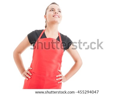 Attractive woman employee on supermarket with red apron posing like superhero isolated on white with copy space area - stock photo