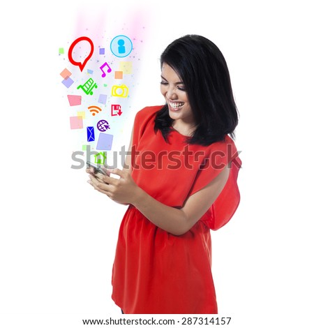 Attractive woman having fun with her mobile phone and use social media app - stock photo