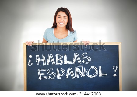 Attractive woman holding a board against room overlooking city - stock photo