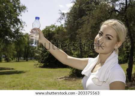 attractive woman holding a bottle of water - stock photo