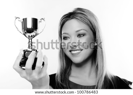 attractive woman holding a trophy in her hands - stock photo