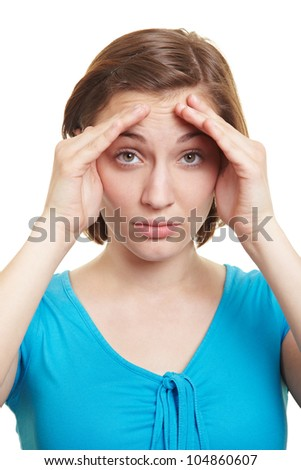 Attractive woman holding hands beside her eyes as blinkers - stock photo