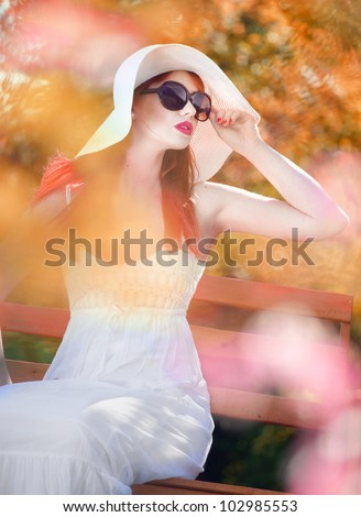 Attractive woman in a magic garden - stock photo