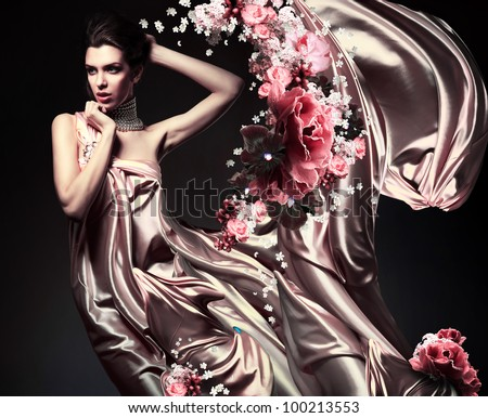 attractive woman in beautiful fabric and flowers - stock photo
