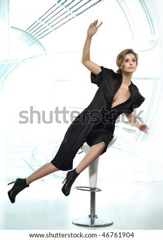 attractive  woman in  dress on modern background - stock photo