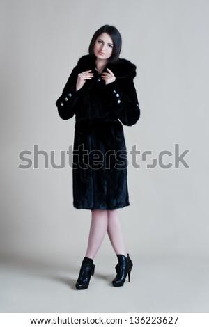 Attractive woman in fur coat - stock photo