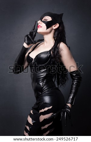 attractive woman in leather latex cat costume - stock photo