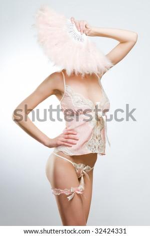Attractive woman in pink lingerie, studio shot - stock photo