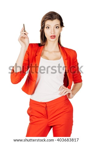 Attractive woman in red suit with an expression that shows she is having a problem on glass board with a pen. isolated on white background. business and lifestyle concept - stock photo