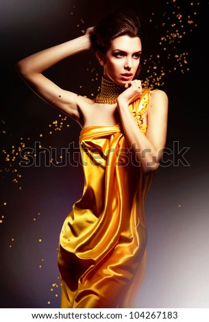 attractive woman in yellow dress - stock photo