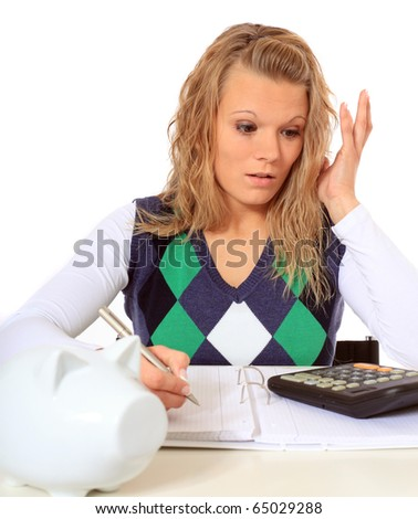 Attractive woman is shocked while doing her budgeting. All on white background. - stock photo