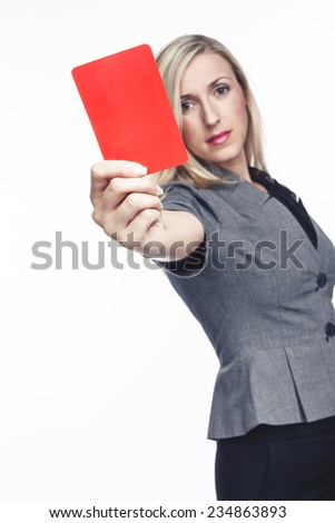 Attractive woman issuing a red card holding it up in her hand to indicate that a player is to be sent off the field, on white - stock photo