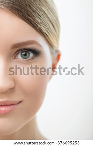 Attractive woman looking at you on white background  - stock photo