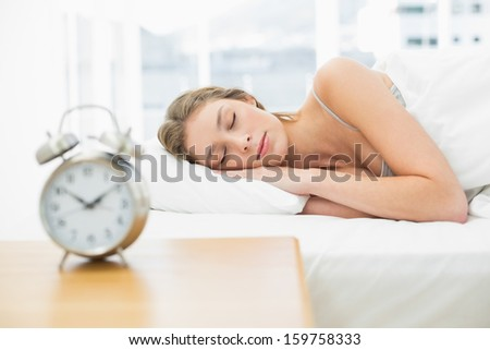Attractive woman lying in her bed sleeping at home - stock photo