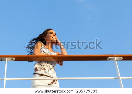 attractive woman on cruise daydreaming - stock photo
