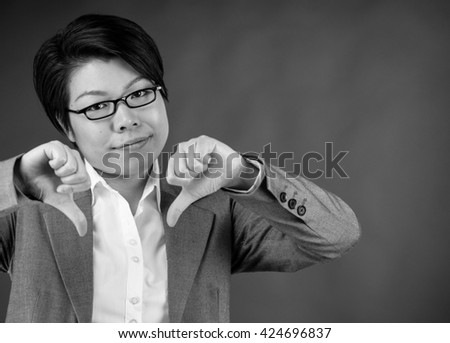 attractive woman on plein background shot in studio with soft lights with an interesting expression and dramatic lighting Black And White, b&w - stock photo