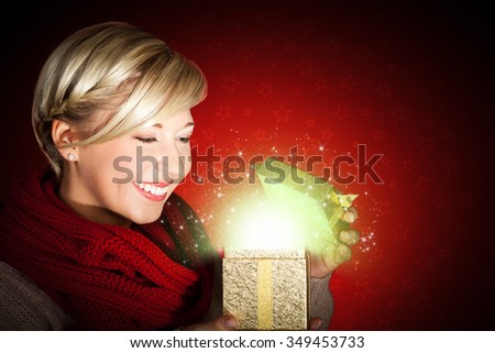 attractive woman opening a gift - stock photo