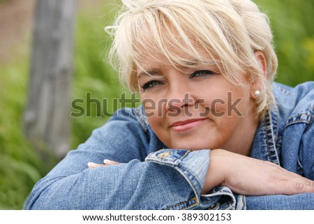 Attractive woman outdoors looking pensive. - stock photo