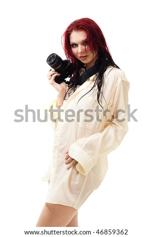 attractive woman photographer in wet clothes with camera - stock photo