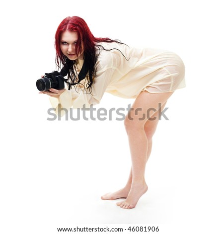 Attractive woman photographer posing, standing in wet clothes, isolated - stock photo