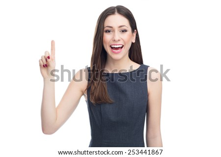 Attractive woman pointing up - stock photo