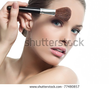 attractive  woman portrait on white background with brush - stock photo