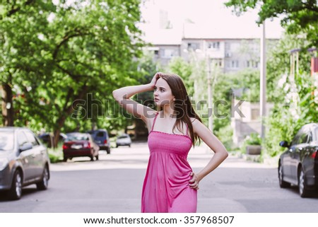 Attractive woman posing on the street - stock photo
