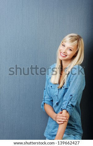 Attractive woman posing over the grey background - stock photo