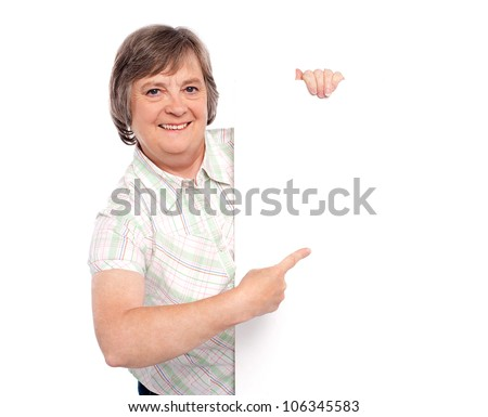 Attractive woman presenting an advertising board isolated against white background - stock photo