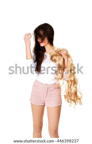 Attractive woman pulls his wig out. - stock photo