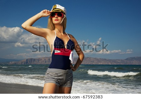 Attractive woman relaxing in the sea - stock photo