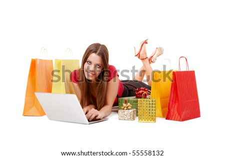 Attractive woman shopping over internet. - stock photo
