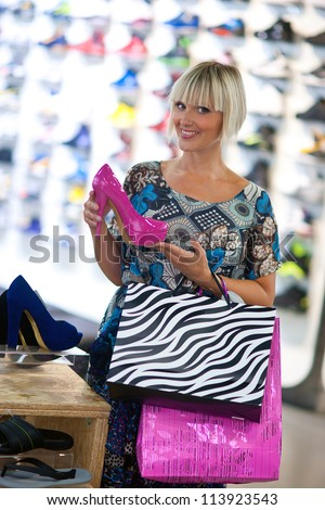 attractive woman shopping shoes in the store - stock photo
