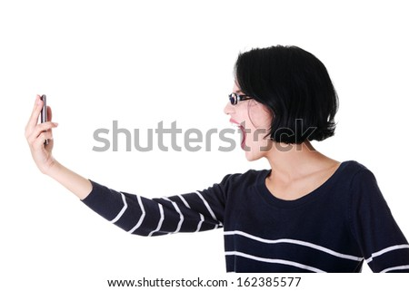 Attractive woman shouting to the phone. Isolated on white.  - stock photo