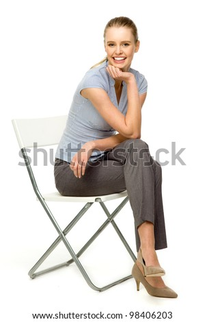 Attractive woman sitting on chair - stock photo