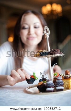 Attractive Woman taking desserts - stock photo