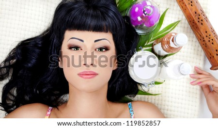 Attractive woman waiting for spa treatment with sea salt and towel - stock photo