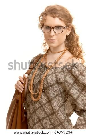 Attractive woman wearing glasses going to schoolgirls holding handbag.? - stock photo